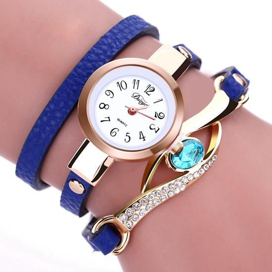 Women Luxury Gold Eye Gemstone Dress Watches