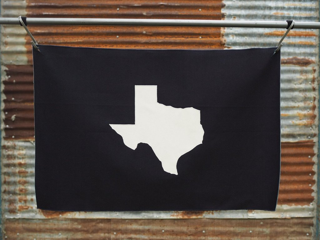 Navasota Co - Outline flag, A blue flag with a white applique image of Texas
