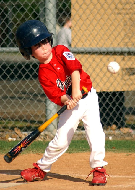 youth baseball glove and bat