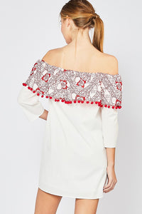 White off shoulder dress with red embroidery