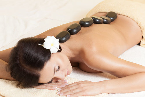 Hot stone massage adds heat to help loosen muscles