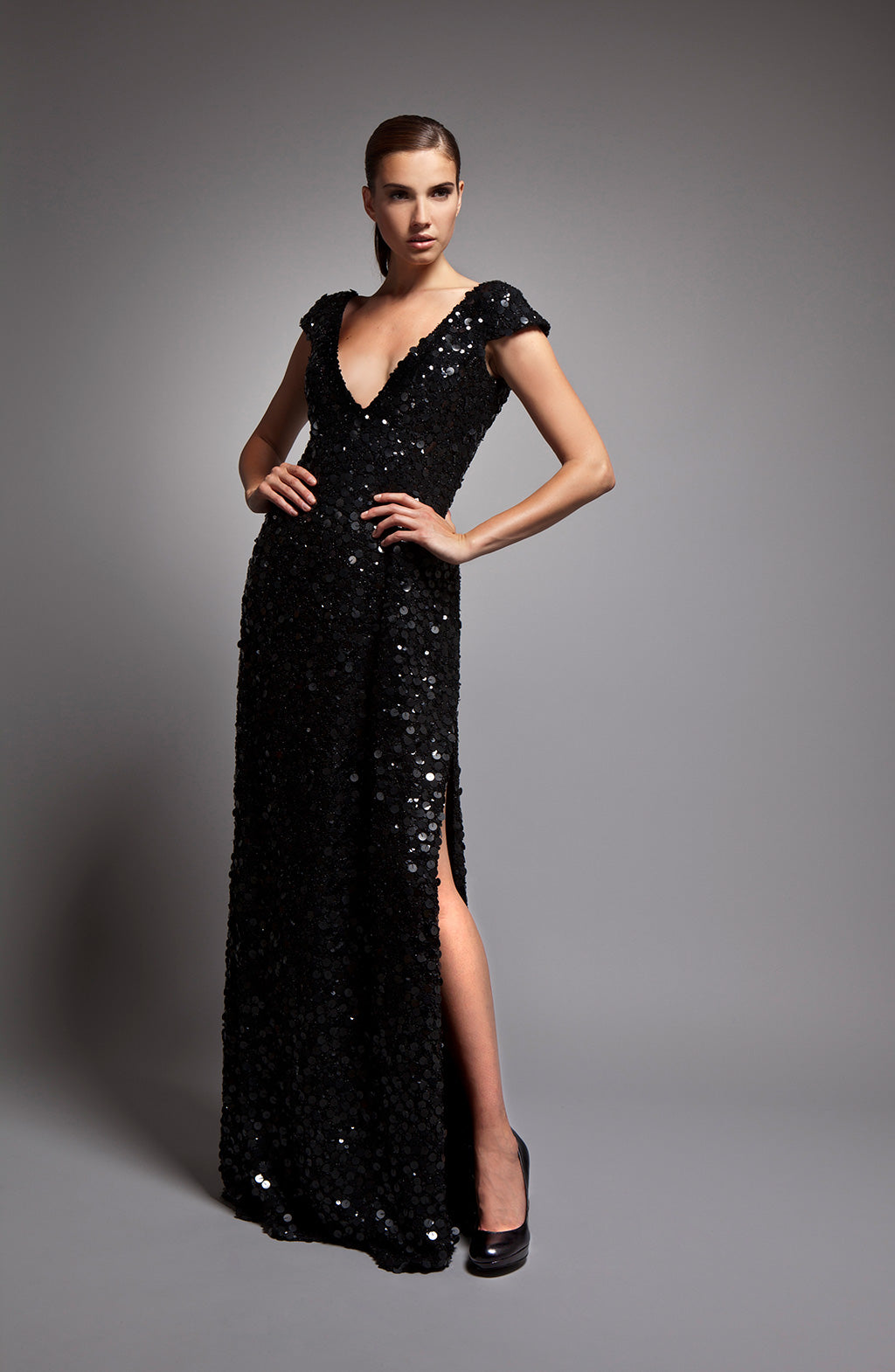 Jacqueline - Black sequin dress with deep v-neck and cap sleeve
