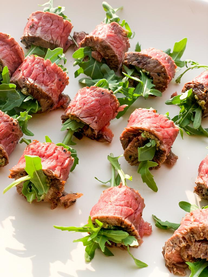Rare beef rolls filled with Morella Grove basil pesto and rocket
