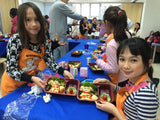 Children are cooking in the Stormy Chefs Cooking Party