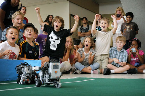Children are having robot competition in party