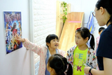 Children playing detective game in Sherlock Holmes Party in Kwun Tong