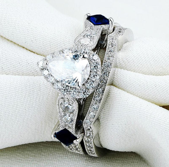 Silver ring set with shape of pear crystal 925