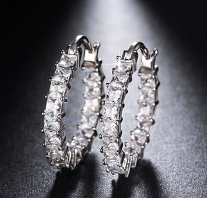 Round-shape earrings with 0.1ct brilliant austrian cubic zirconia