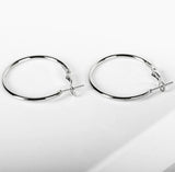 Big round smooth hoops earrings