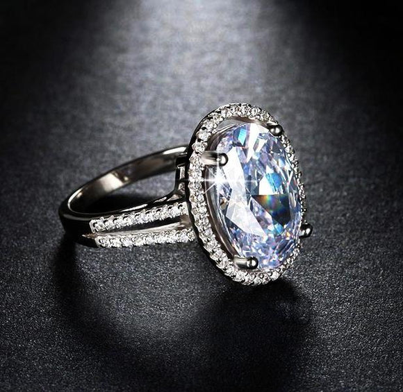 Big oval cut AAA zircon ring with micro paved cubic zirconia