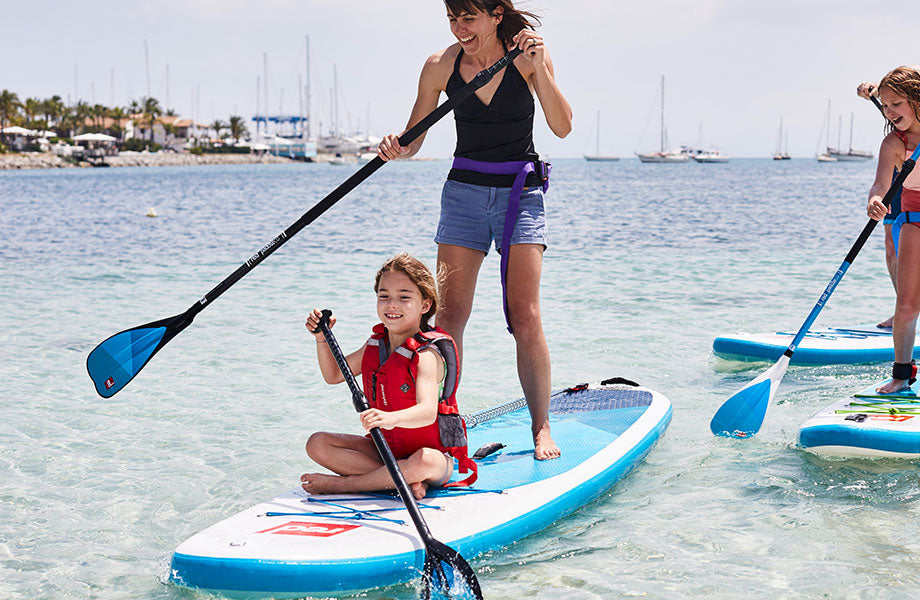 Mother and Daughter Paddle Boarding together