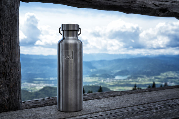 red originals insulated drinks bottle looking over mountains