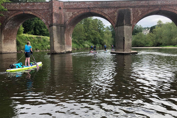 Man Paddleboarding on River - The Original Adventure - The Wye 100
