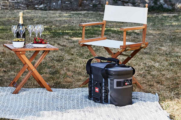 An Outdoor Picnic With folding chairs, a folding table, and a waterproof cooler bag