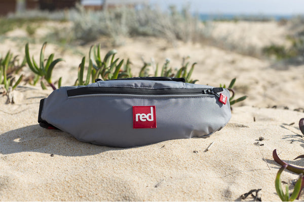 The Red Original Airbelf PFD On A Bed Of Sand