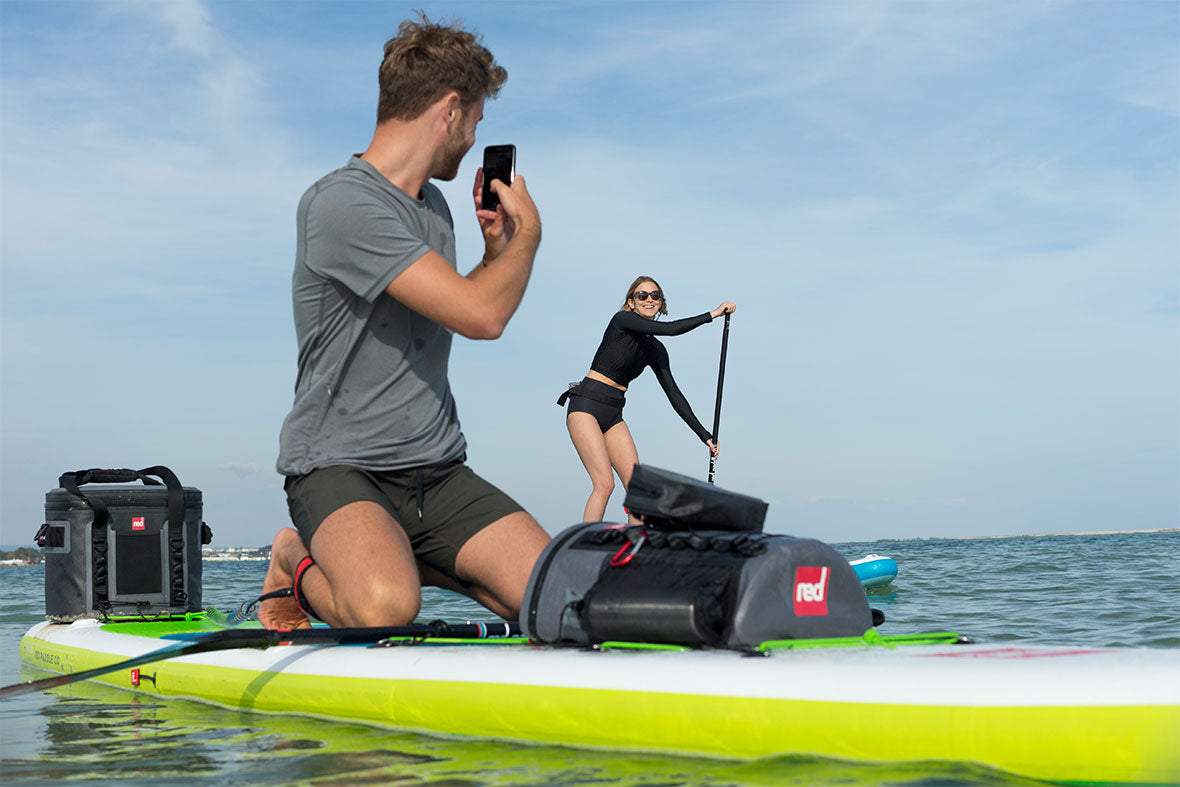 The Deck Bag and Dry Pouch with people on paddle boards