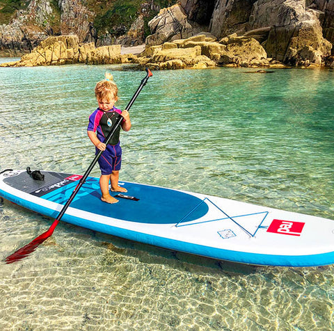 Toddle standing up on Red Paddle Co board
