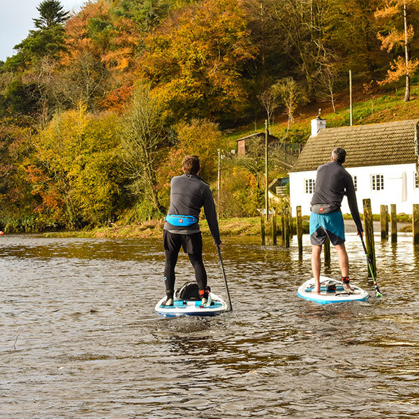 Men paddling away on stand up paddle boards