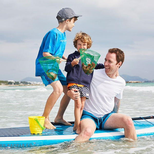 Man and 2 boys on a paddle board