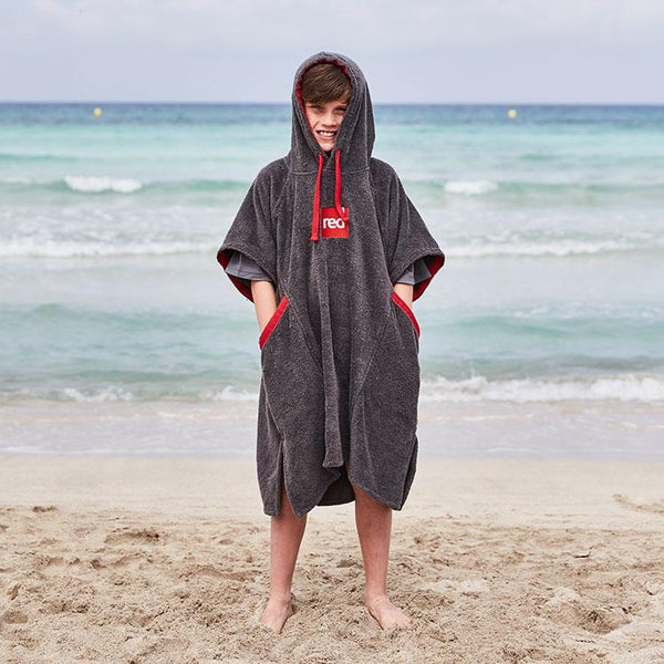 young boy wearing Kid's Luxury Towelling Change Robe on the beach