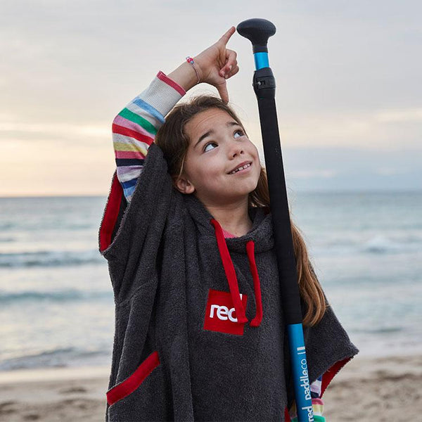 young girl with paddle wearing Luxury Kids Poncho Towel Change Robe