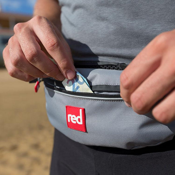 Accessing the stash pouch on the Red Original Airbelt PFD