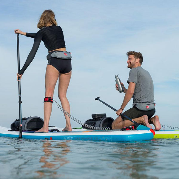 Couple on the water wearing Red Original Airbelt PFDs