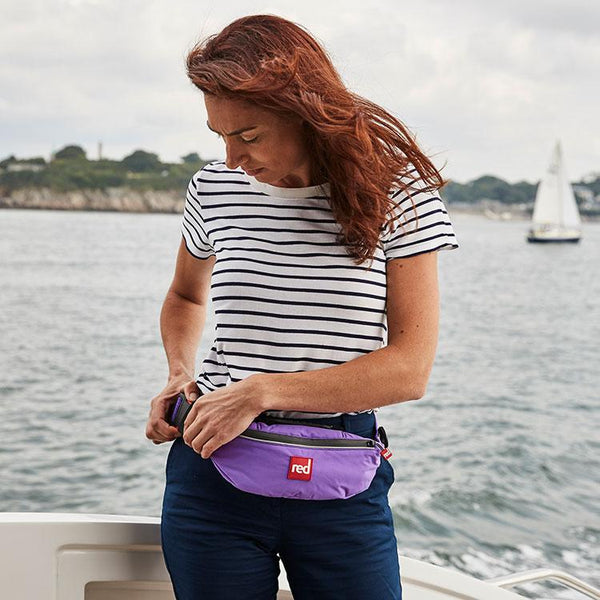 women wearing the purple Airbelt Personal Flotation Device (PFD)