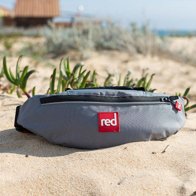 Red Original Airbelt PFD in the sand