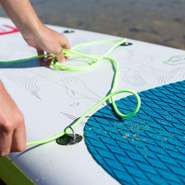 Red Original Green Cargo Bungee being fitted to a board