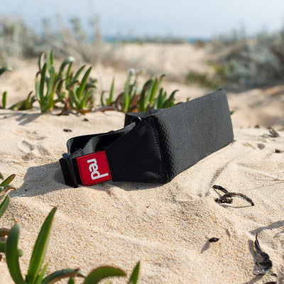 Red Original carry strap in the sand