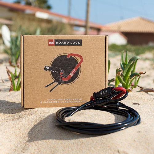 Red Original combination board lock in the sand with packaging