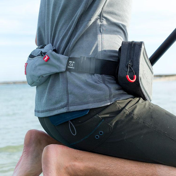 Red Original Waterproof Pouch attached to a airbelt pfd