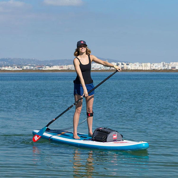 Woman wearing a Red Original paddle cap whilst paddle boarding