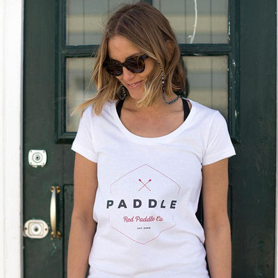 Women wearing Red Original Paddle On t-shirt in front of door