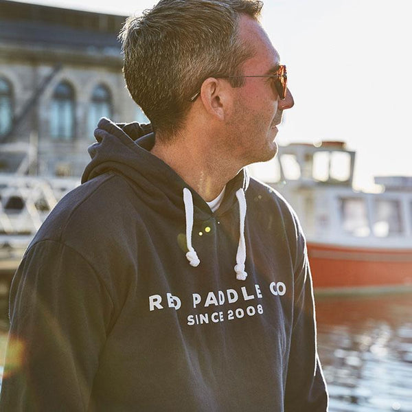 Man wearing Red Paddle Co Since 2008 Unisex Hoodie - Blue