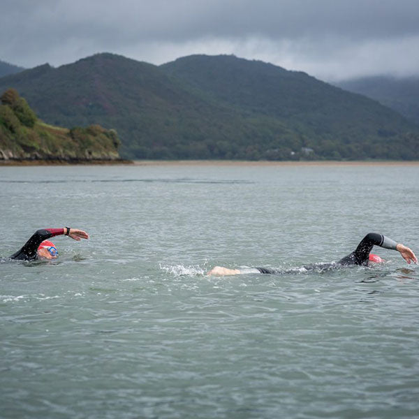 Outdoor Swimmers Doing Front Crawl