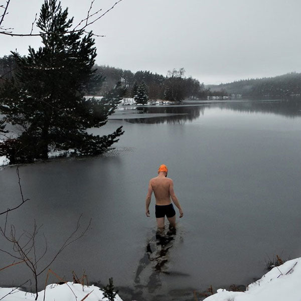 Man Walking Into Cold Water