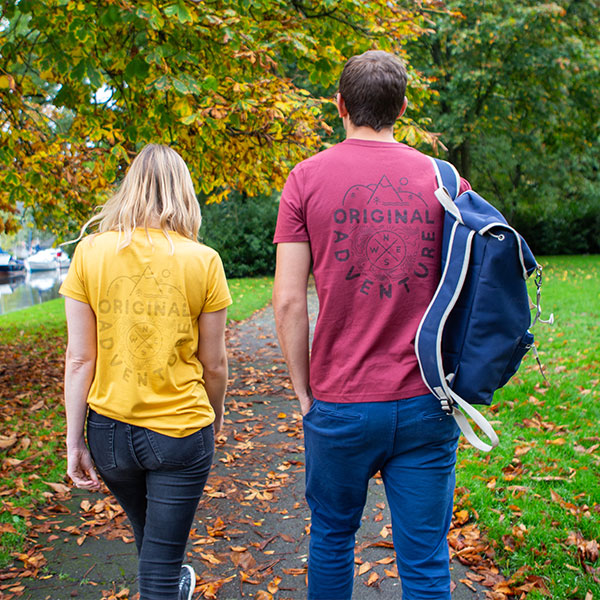 Man And Woman Wearing The Mustard Yellow & Red Wine T-shirts In A Park