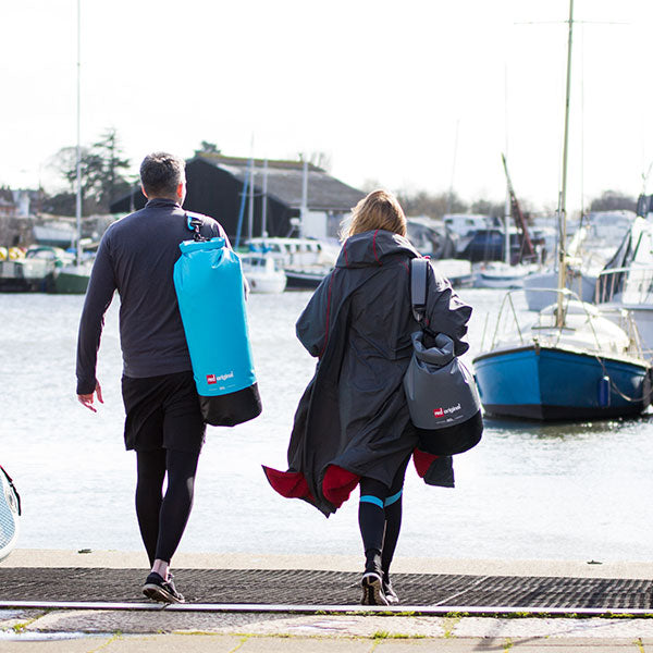 Male and female carrying dry bag