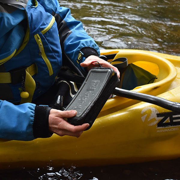 A Kayaker Using The Waterproof Pouch