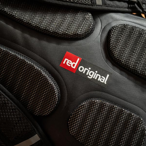 Close up of the Red Original Logo on the 30 Litre Waterproof Backpack