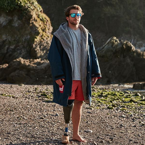 Man wearing a Navy long sleeve waterproof changing robe with the hood down