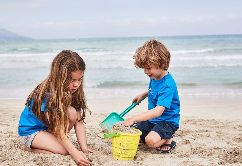 children making sandcastles at beach