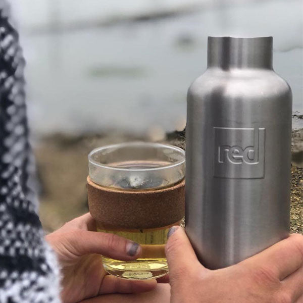 Pouring a drink from a Red Original Insulated Stainless Steel Water Bottle