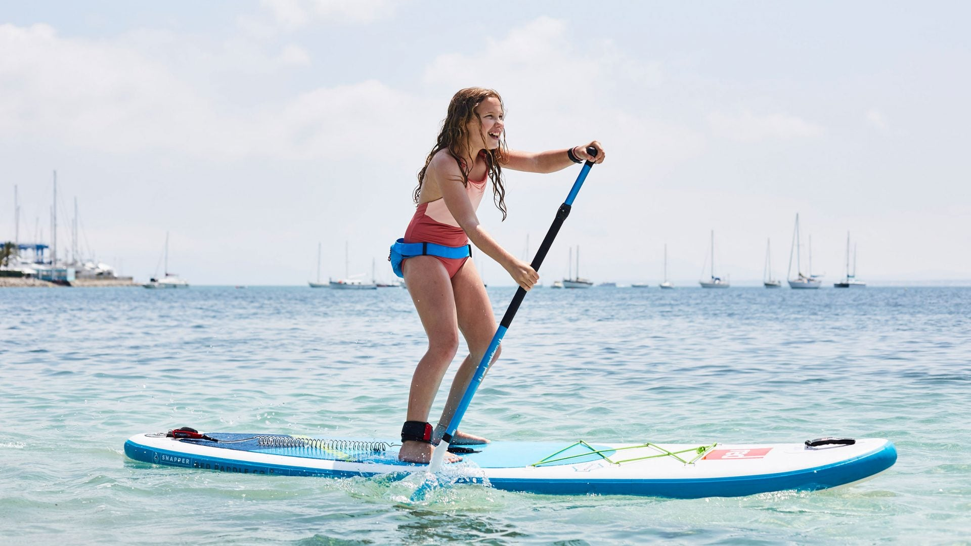 Girl Paddle Boarding With Airbelt PFD