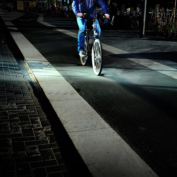 Riding a bike in a cycle lane in the dark