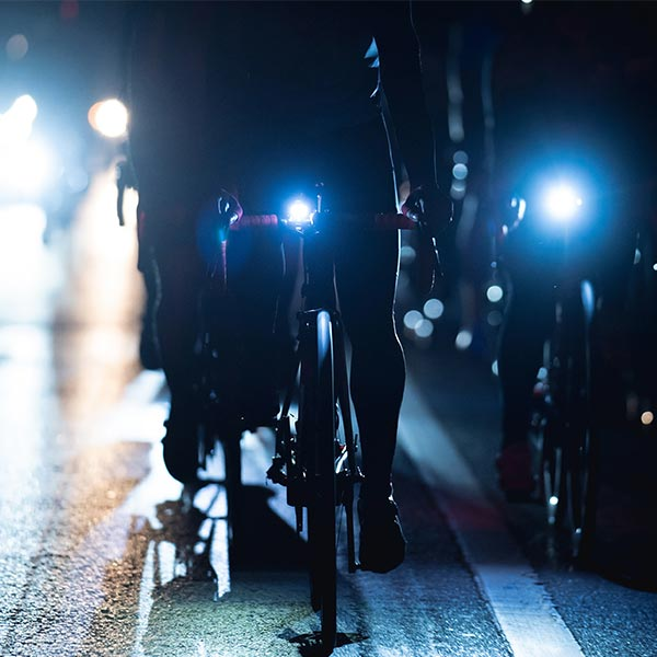 People riding bikes at night