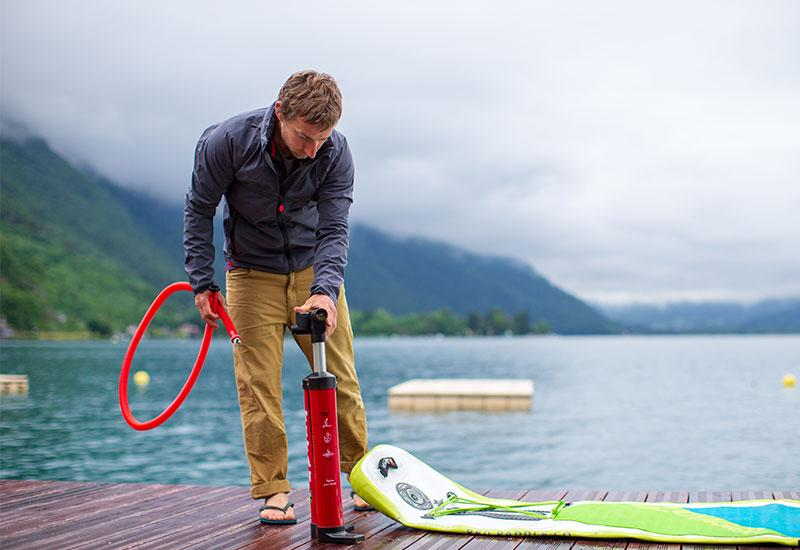 Man Inflating SUP Board