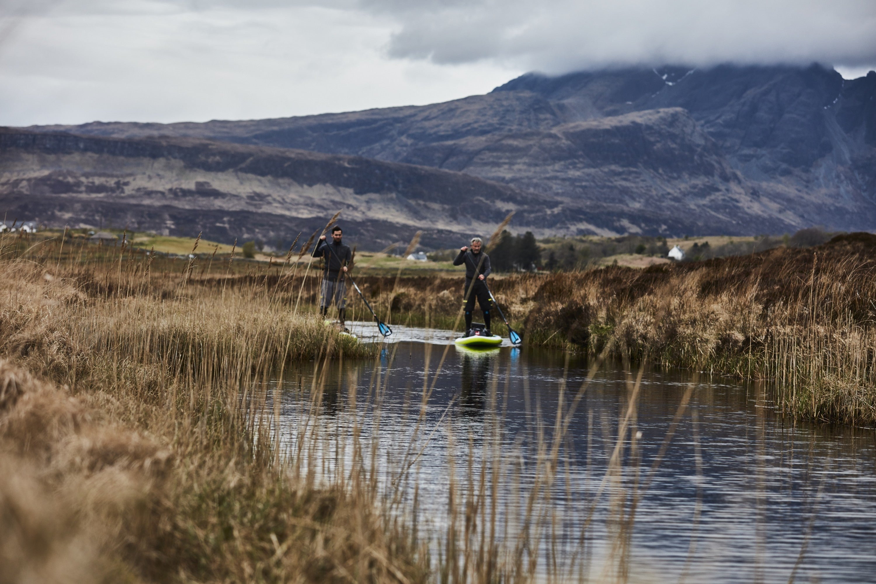 Men Paddling through Scotland in cold weather